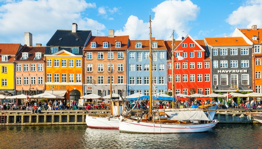 Nyhavn pier with colorful buildings and boats in Copenhagen