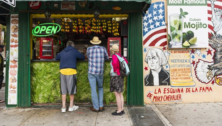 Miami Tourists Order From Window of Little Havana Restaurant.