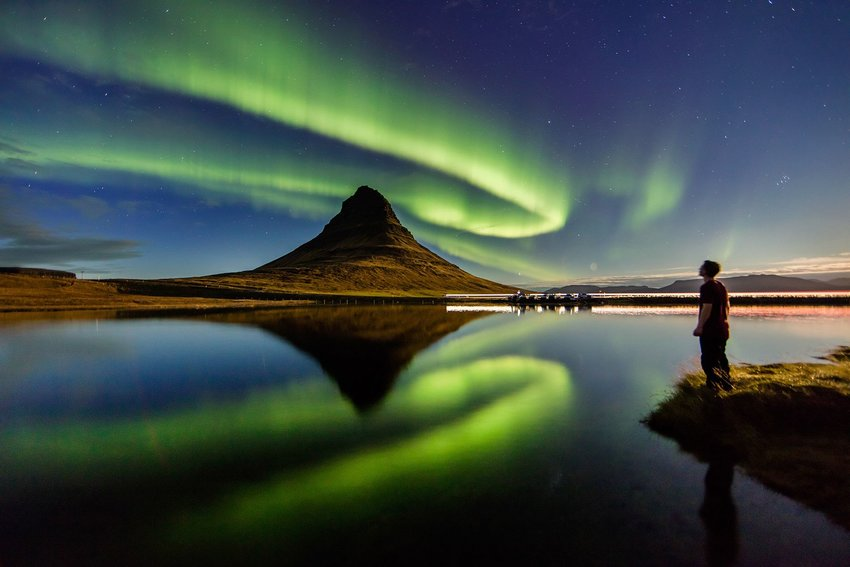 Person observing the Northern Lights in Kirkjufell, Iceland
