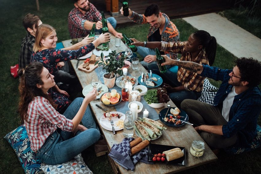Photo of friends around an outdoor dinner table
