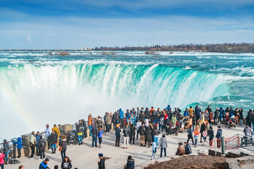 Photo of Niagara Falls and a crowd looking on