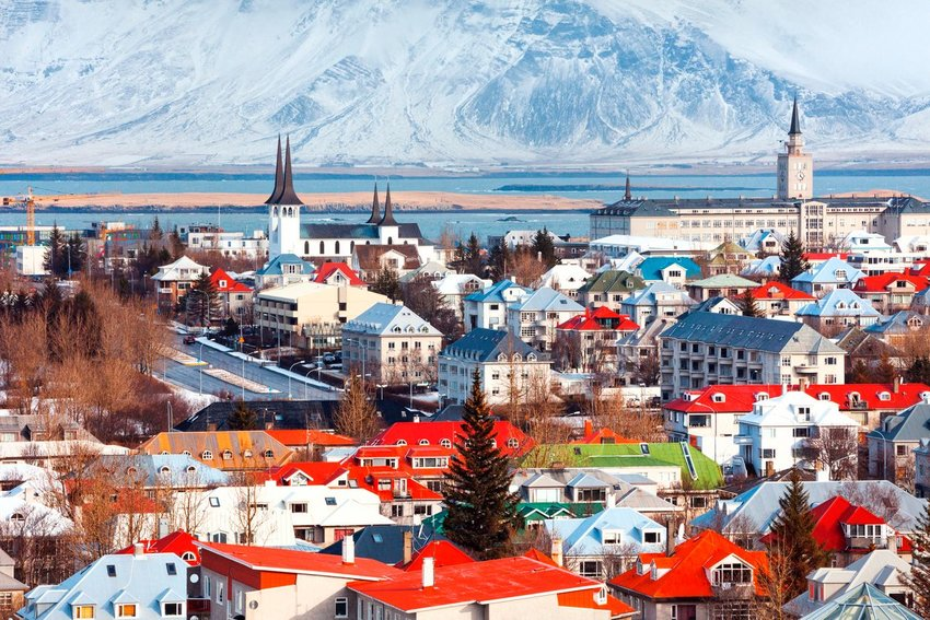 Aerial photo of the city of Reykjavik with a mountain in the background
