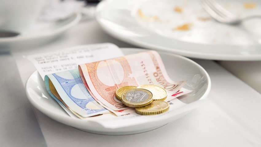 Plate with Euros at a restaurant