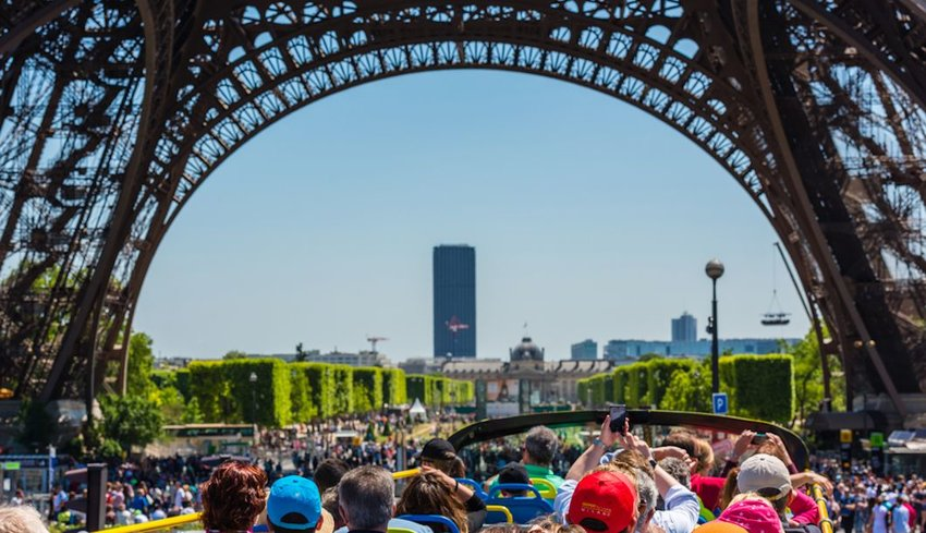 Crowds of tourists under the Eiffel Tower