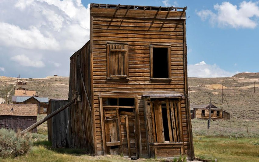Photo of abandoned wooden building in Old West town