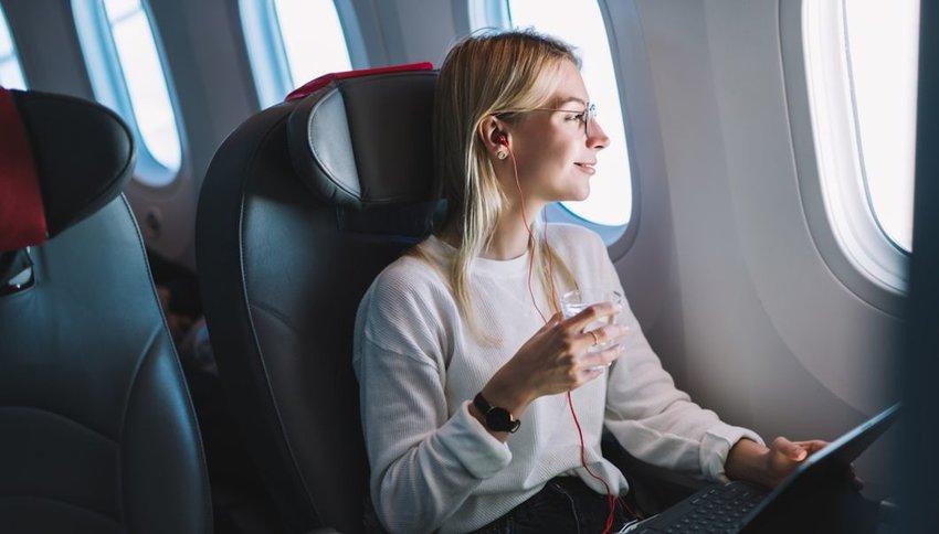 smiling woman enjoying her comfortable flight