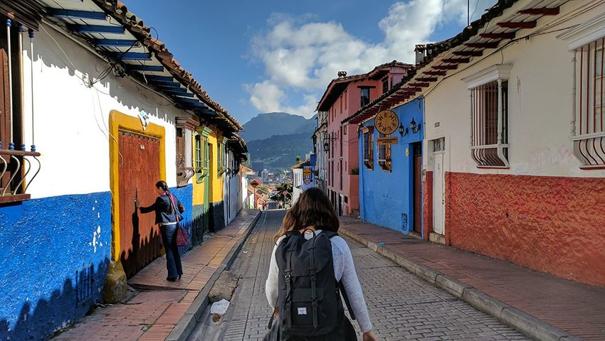 Woman walking in the La Candelaria neighborhood of Bogotá, Colombia