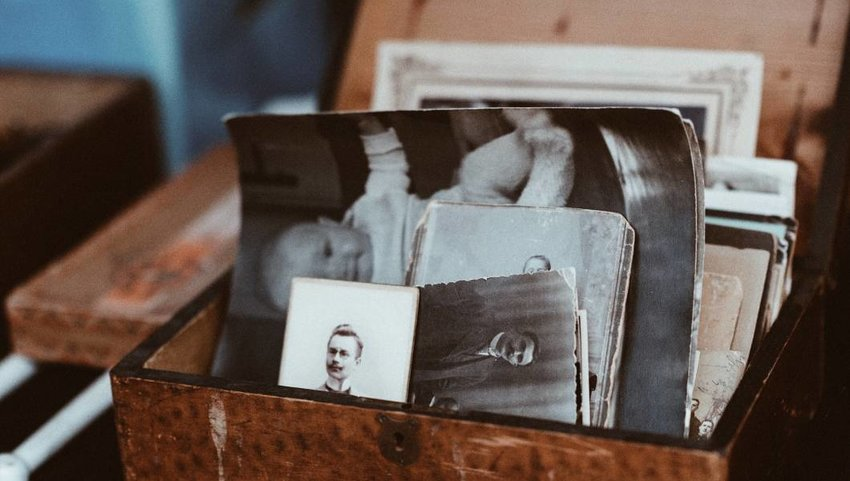 Old photo trunk with black and white photos.