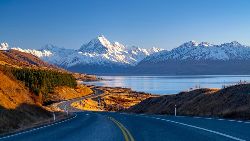 Scenic winding road along Lake Pukaki to Mount Cook National Park