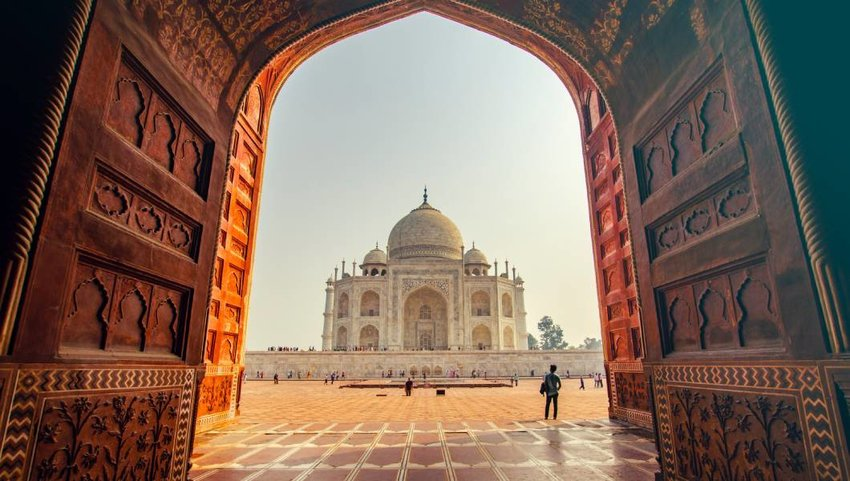 The Taj Mahal viewed through an archway.