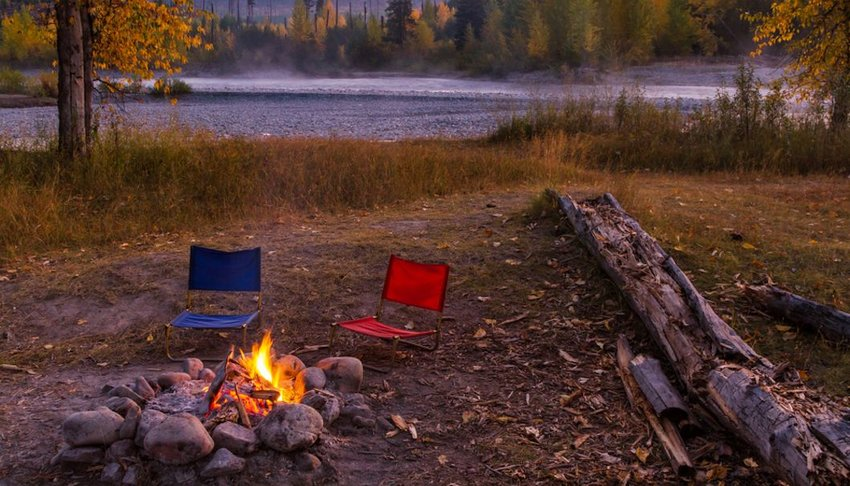 Chairs around a campfire in Glacier National Park