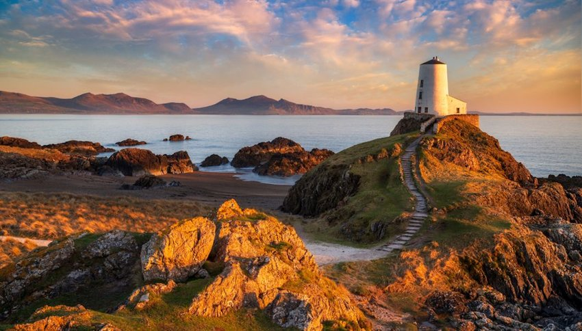 Sunset behind lighthouse on Llanddwyn Island