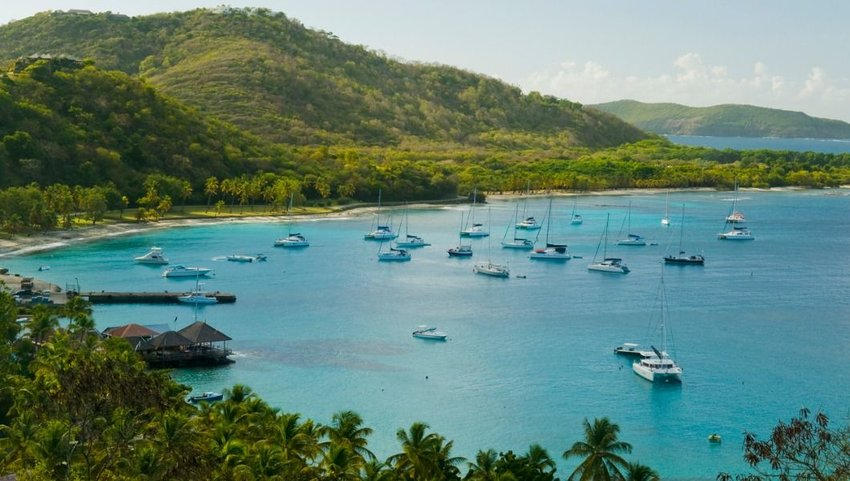 Aerial view of blue waters and anchored ships, Britannia Bay, Mustique