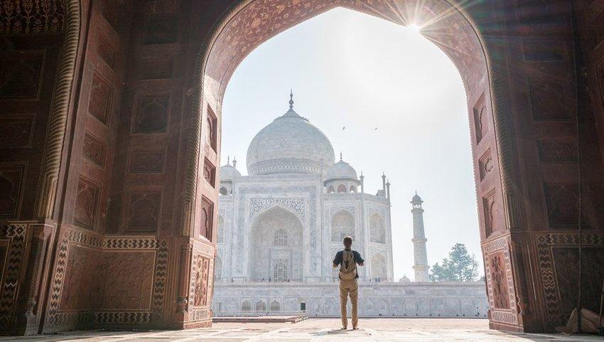 Man looking at the Taj Mahal in India