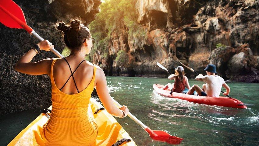 People kayaking in ravine