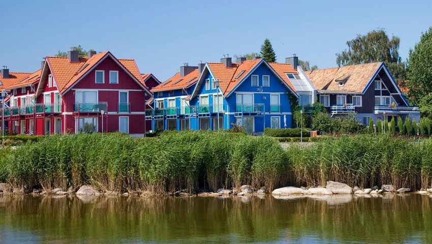 Brightly colored homes in Nida, a small fishing village near the Curonian Spit, Lithuania