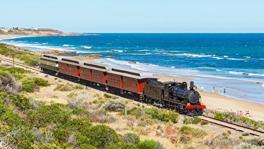 SteamRanger's iconic steam-hauled Cockle Train passing by the beach, South Australia