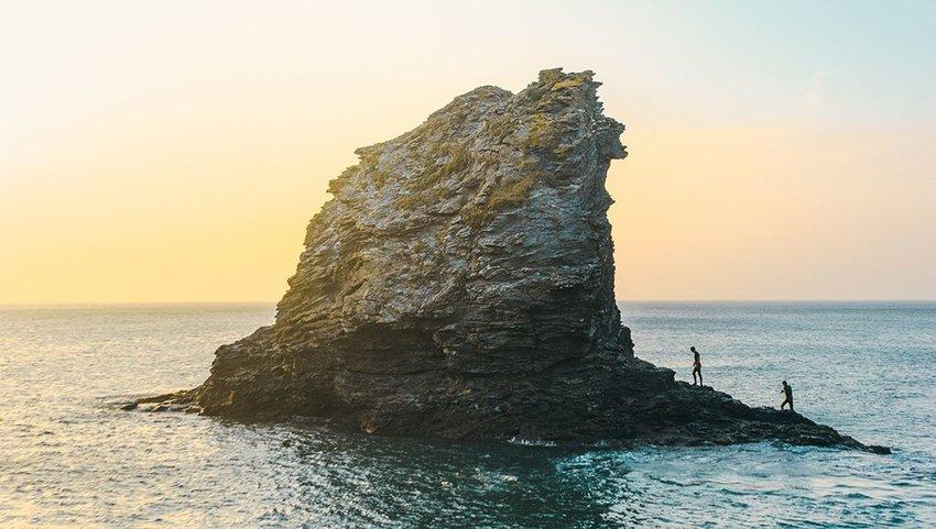 Two people exploring Trevellas Cove, Saint Agnes, United Kingdom