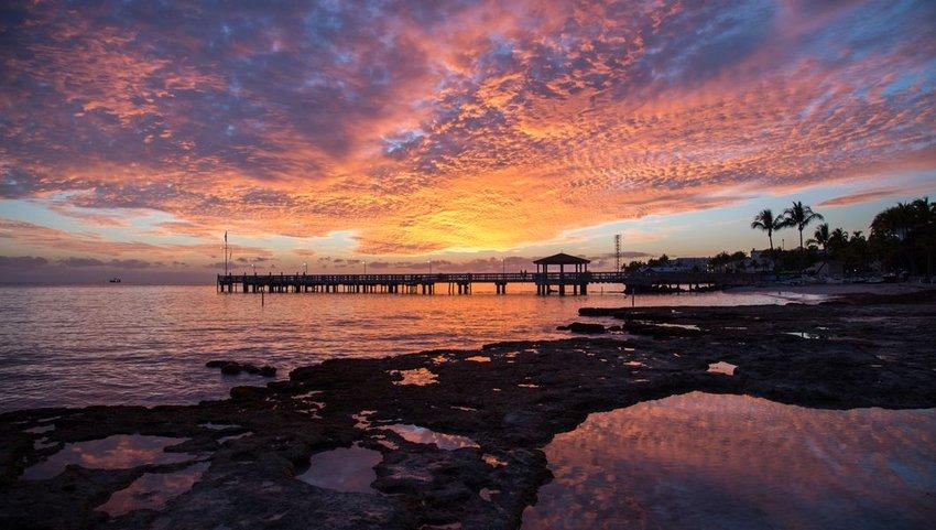 Orange sunset over pier at Key West Island, Florida