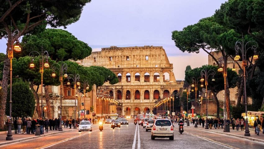 Traffic in street, Colosseum, Rome, Italy