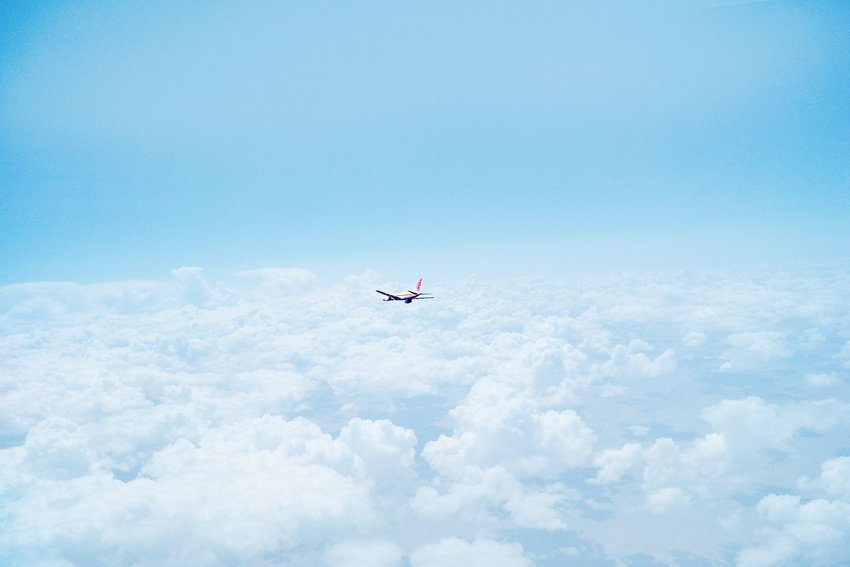Plane flying above clouds.