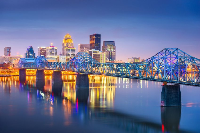 Louisville, Kentucky, USA downtown skyline on the Ohio River at dusk