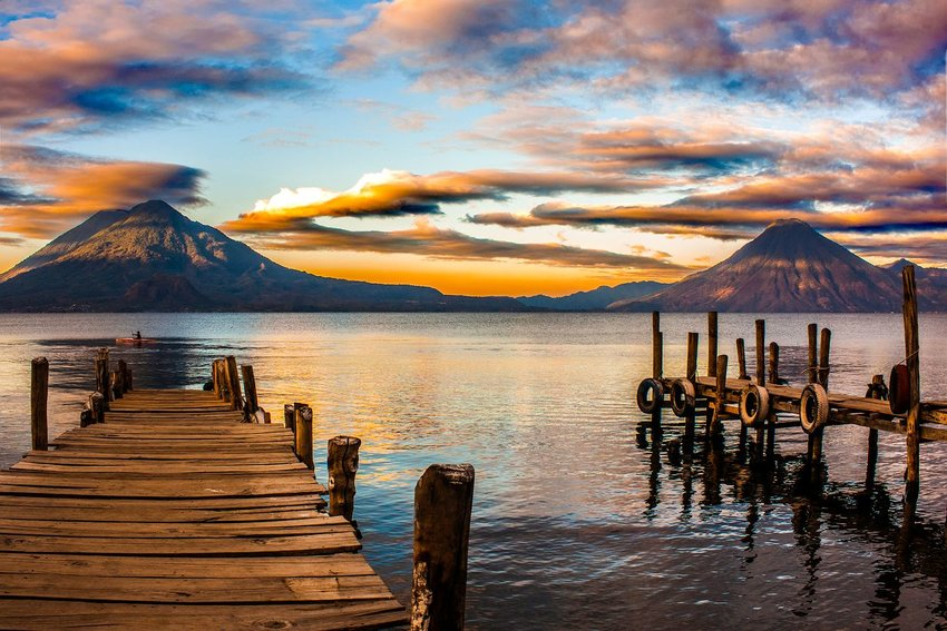 View of Lake Atitlan, Guatemala with mountains in background at sunset