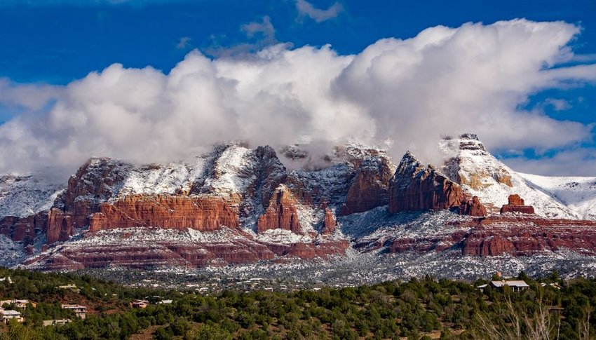 Mountains covered in snow with clouds in Sedona, Arizona