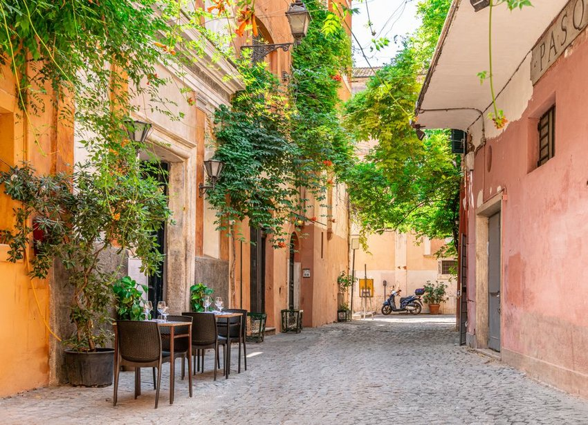 Cozy street with plants in Trastevere, Rome, Europe