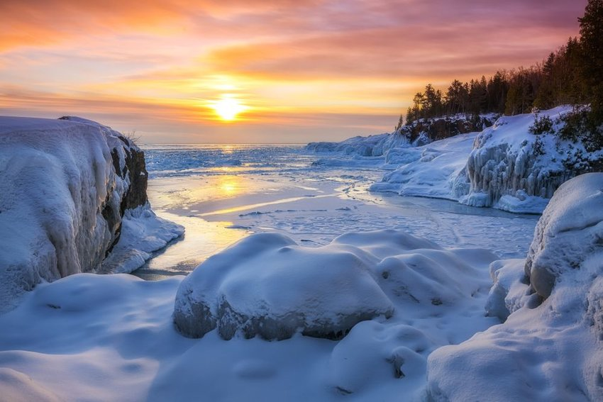 Frozen Lake Superior sunrise at Presque Isle Park, in Marquette, Michigan