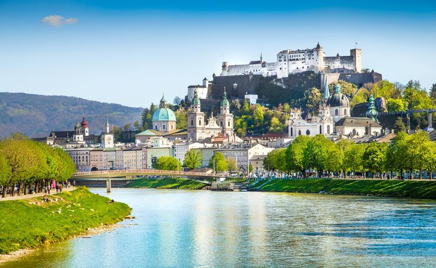 Salzburg skyline with Festung Hohensalzburg and Salzach river in summer