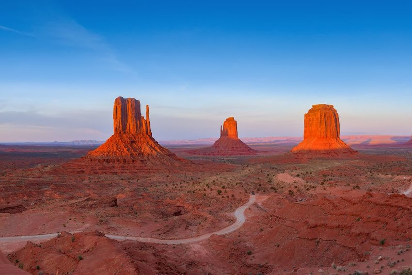 Sunset on Monument Valley, road winding in between