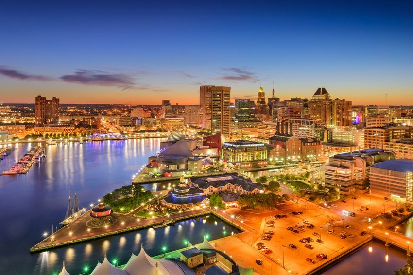 Baltimore, Maryland, USA inner harbor and downtown skyline at twilight