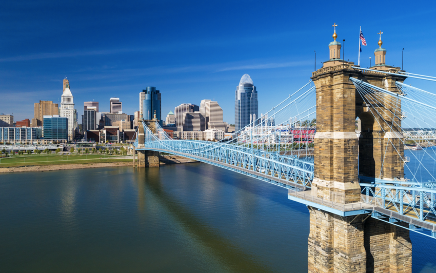 The Roebling Suspension Bridge with Downtown Cincinnati in the background and Ohio River