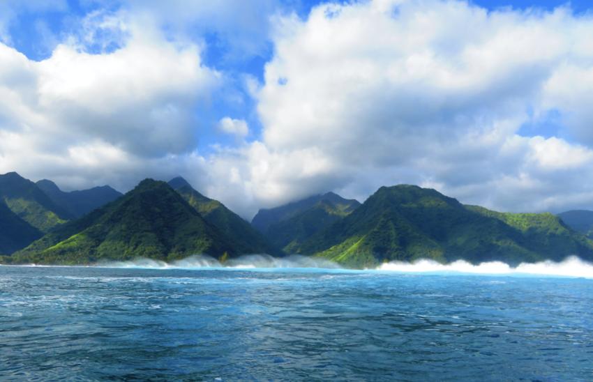Waves crashing against the island of Tahiti