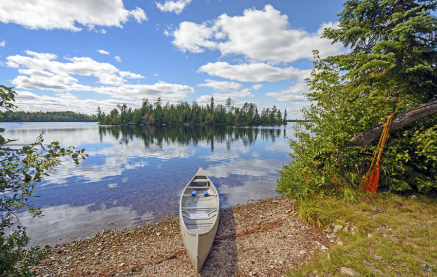 Canoe pulled onto land in Kekekabic Lake in the Boundary Waters