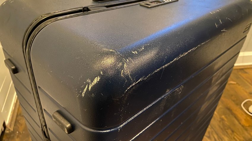 The Away Large checked bag shows a lot of scuffs.