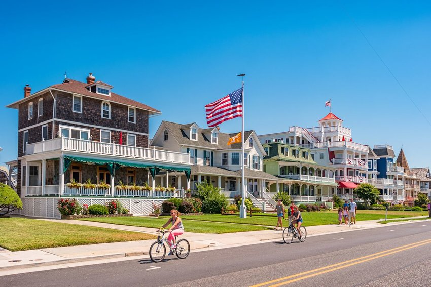 People walking and riding bikes along road in Cape May, New Jersey