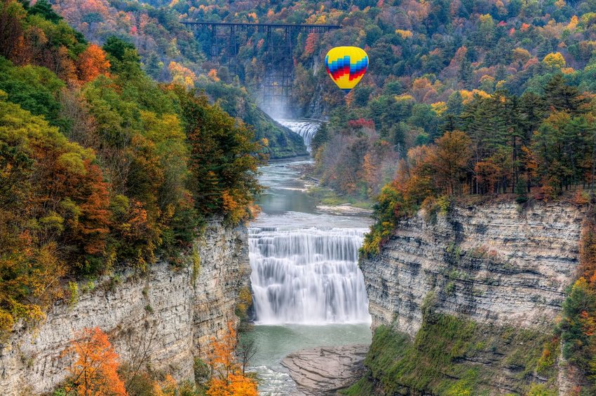Hot air balloon over waterfalls at Letchworth State Park in New York