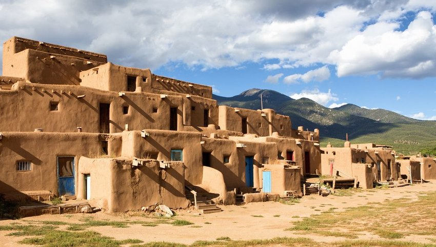 Taos Pueblo with mountains in the background