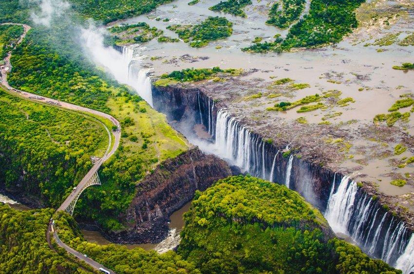 Aerial view of bridge and falls at Victoria Falls