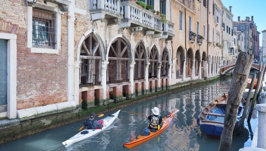 Two people kayaking in Venice's canals