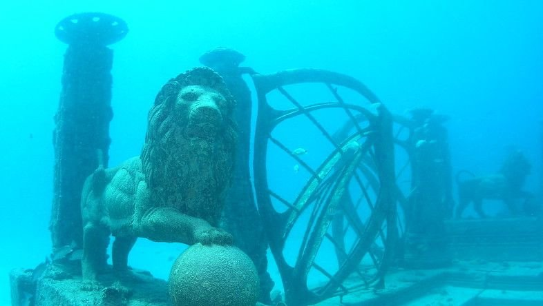 Stone lion and gate underwater