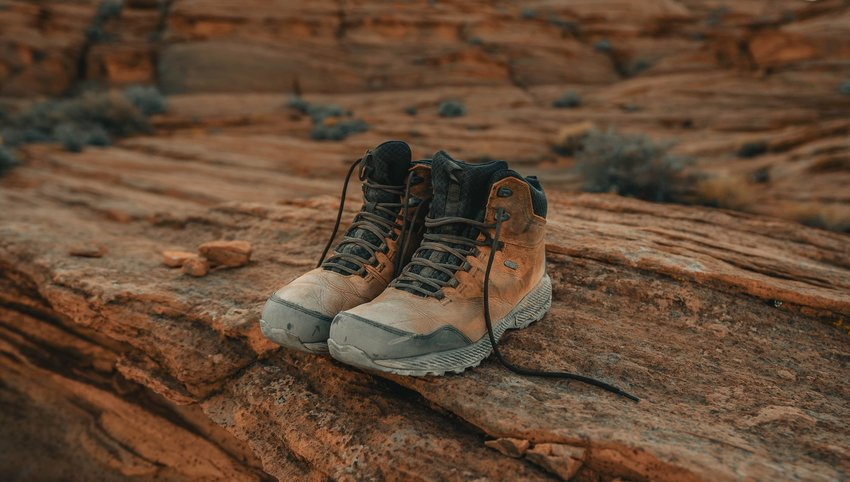 Pair of hiking boots sitting on red rock formation