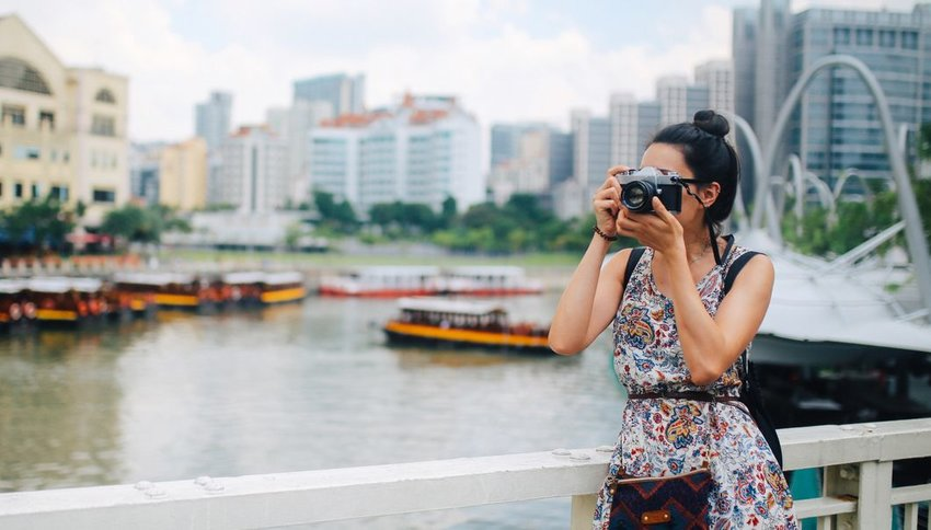 Woman taking photo with film camera