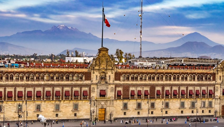Front exterior view of Palacio Nacional with mountain view in background