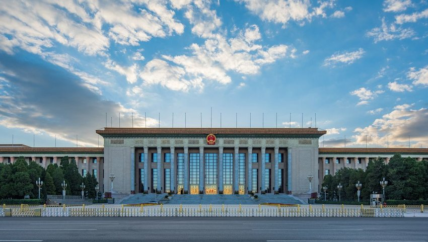 View of front exterior of Great Hall of the People on a cloudy day