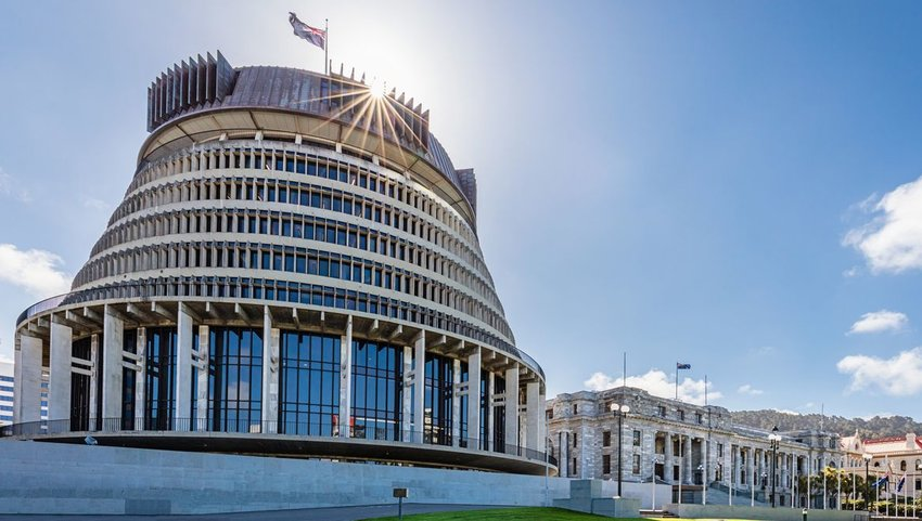 Exterior of the Beehive with New Zealand flag on top of building