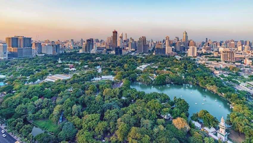 Aerial view of Lumpini Park with Bangkok cityscape