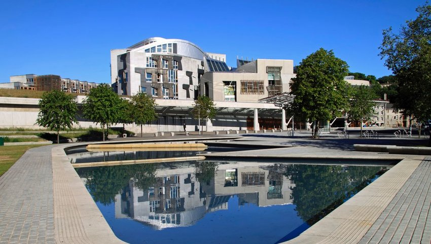 Exterior view of Scottish Parliament Building with man made pond in front